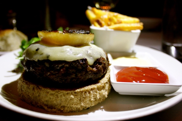 Black Truffle Cheese Burger served open face on Rye with Truffle Fries, $28